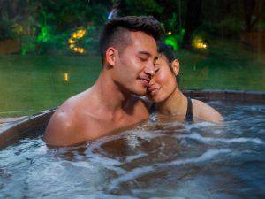 romantic escape - couple in hot tub